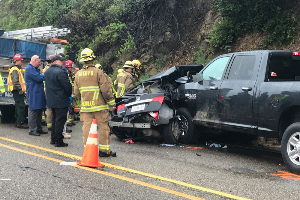 Two people were killed and two were injured Tuesday afternoon in a collision on Highway 154 near Painted Cave Road.
