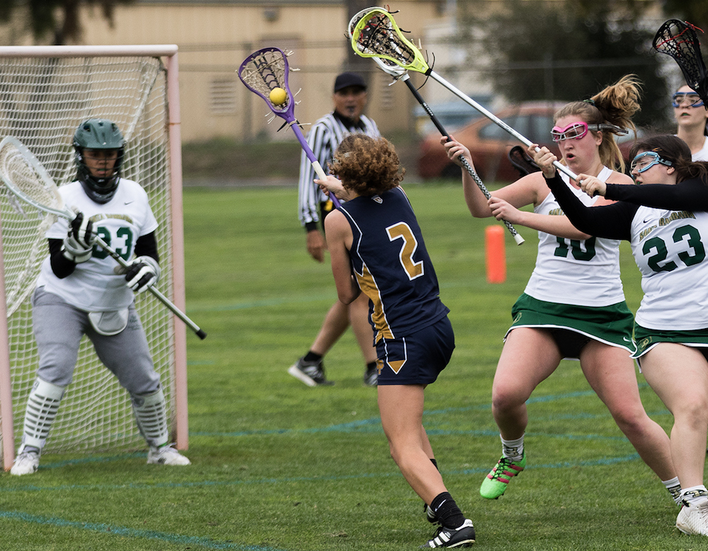 Alexia Vance of Dos Pueblos gets past Santa Barbara defenders for a run on goal. Vance scored four goals.
