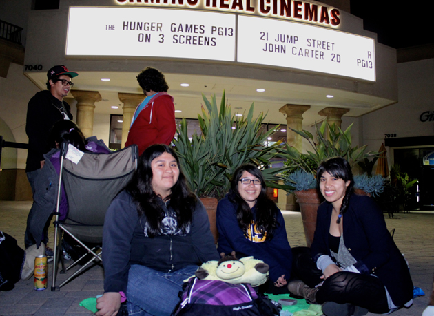 UCSB students Noemy Esparza, left, Amy Maldonado and Ariana Ortega got in line at 8:30 a.m. Thursday for the midnight showing of <i>The Hunger Games</i> at the Metropolitan Camino Real Cinemas in Goleta.&#8221; width=&#8220;630&#8221; height=&#8220;459&#8221; /><div class=