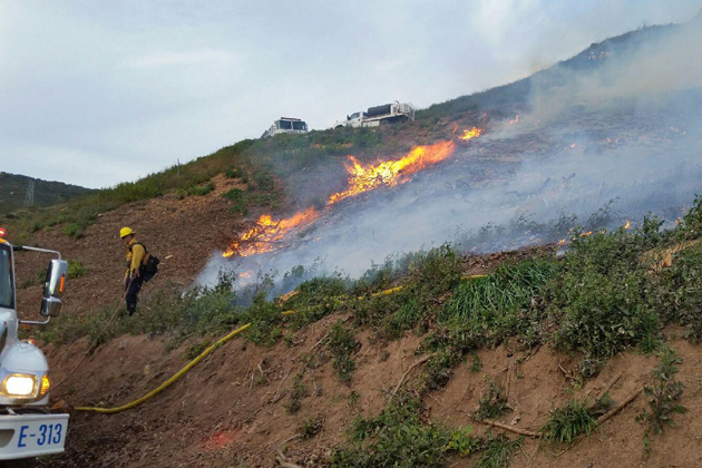 Santa Barbara County Fire crews work to extinguish a vegetation fire Tuesday evening in the Goleta foothills.