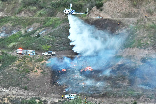 a santa barbara county helicopter drops water on a