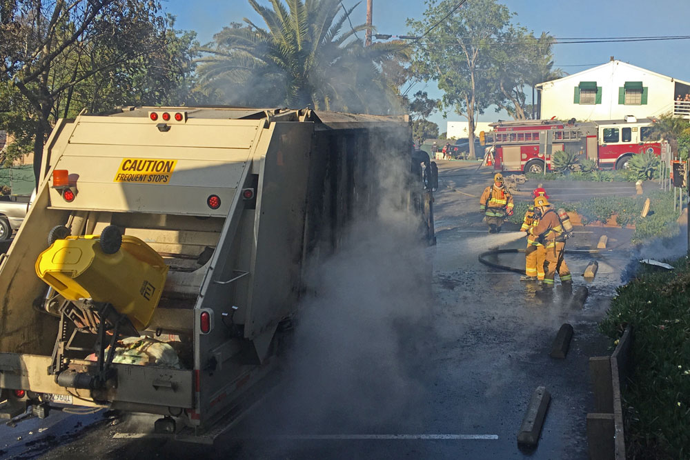 Fire crews respond to a MarBorg Industries garbage truck fire on Coast Village Road Friday morning.
