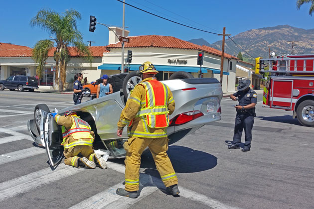 A woman driver suffered minor injuries Saturday in a rollover crash at the intersection of State Street and Calle Laureles in Santa Barbara.