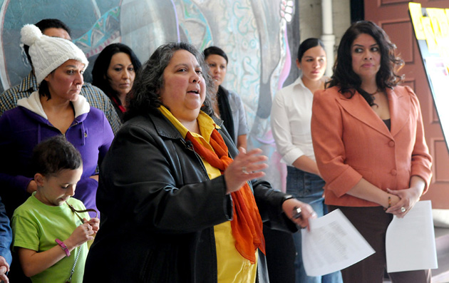 Casa de la Raza Executive Director Raquel Lopez, right, listens as board President Marisela Marquez speaks with the media Tuesday about what it deems were unfair newspaper articles published about the Santa Barbara nonprofit organization.