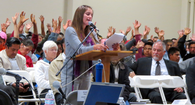 <p>A Santa Maria representative from Community Initiatives for Visiting Immigrants in Confinement explains to the Santa Maria City Council on Thursday why the group appealed an approved permit to build an ICE facility. Attendees showed their support of her comments by waving their hands, since they were not allowed to clap or talk out of turn during the hearing.</p>