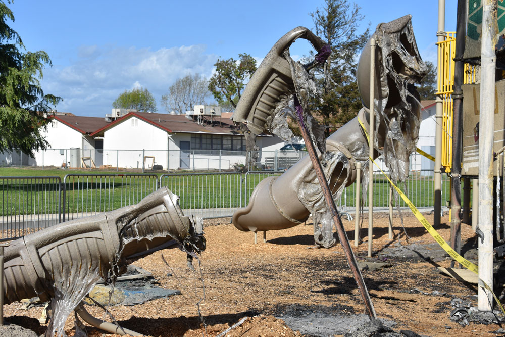 A suspicious fire early Monday caused $200,000 damage to a children's play structure in Armstrong Park in Santa Maria.