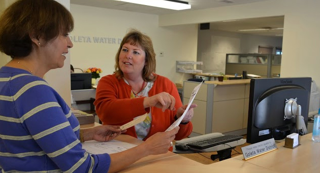 <p>The Goleta Water District's rocky transition to a new billing system has forced agency employees like human resources administrator/customer service supervisor Susie Gregg, right, to spend more time helping customers figure out what they owe as well as their water usage.</p>