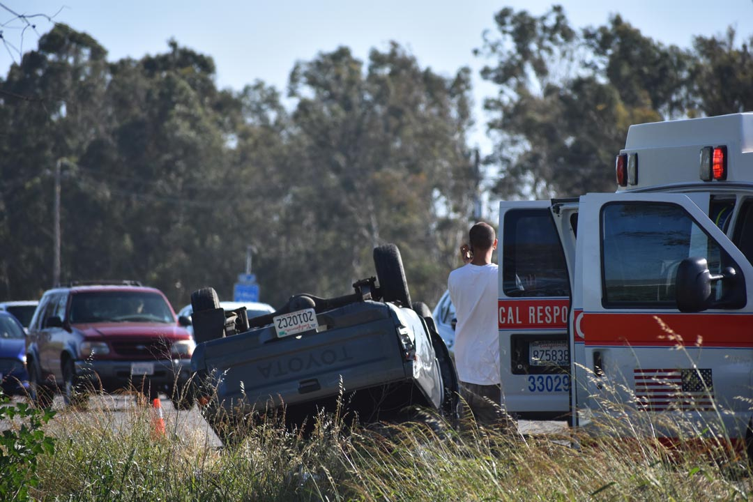 A second car sits on its rooftop after a crash Tuesday afternoon on northbound Highway 101 south of Betteravia Road.
