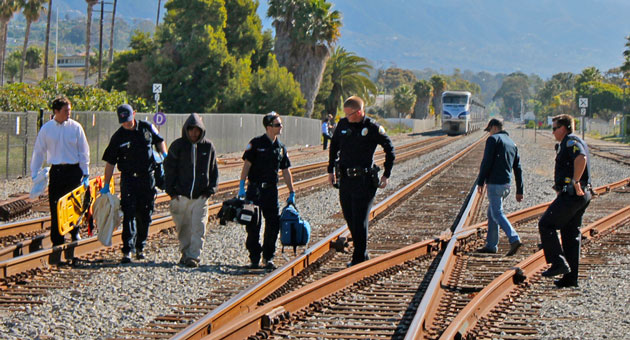 Emergency personnel head back to their stations Sunday morning after responding to a pedestrian, in hooded sweatshirt, above, who suffered minor injuries when he was clipped by a train in Santa Barbara. (Urban Hikers photo)