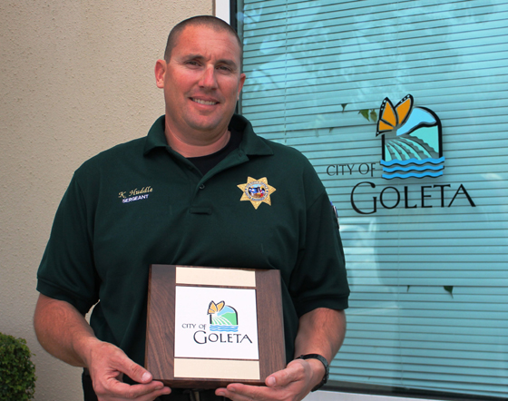 <p>Sheriff&#8217;s Sgt. Kevin Huddle receives a city tile Tuesday in recognition of his service to Goleta.</p>