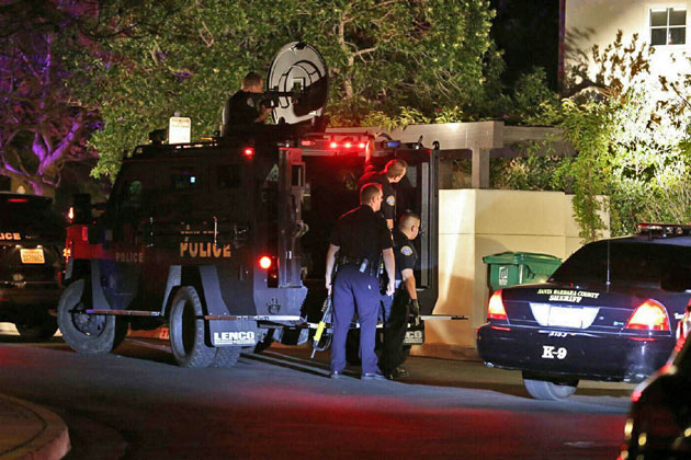 Santa Barbara police officers use the department's armored Bearcat vehicle Friday night while trying to subdue a man who was barricaded in a condominium and making threats towards law enforcement. He later surrendered.