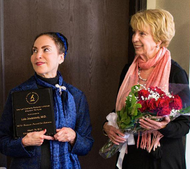 <p>Dr. Lois Jovanovic, left, receives the prestigious William D. Sansum Award for Excellence in Science during last Friday&#8217;s meeting of the Sansum Diabetes Research Institute Board of Trustees.</p>