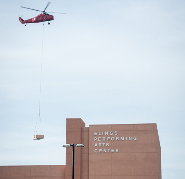<p>A helicopter removes aged HVAC units from Dos Pueblos High School.</p>