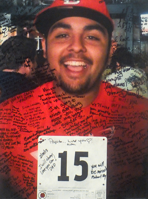 A poster is filled with memories and love for Simon Chavez, 22, of Santa Barbara, who was killed by a hit-and-run-driver on Highway 101 in January. (Lara Cooper / Noozhawk photo)
