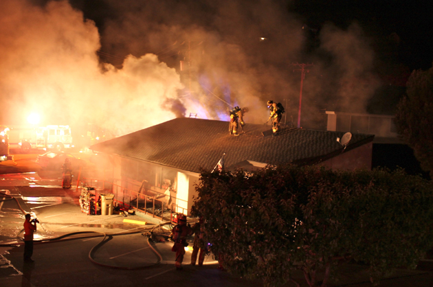 Firefighters attack the blaze from the top of the Hi Time Stop & Shop building. (Urban Hikers photo)