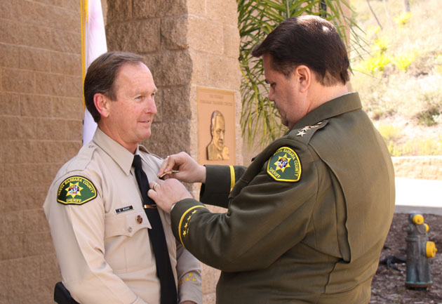 Santa Barbara County Sheriff Bill Brown honors Lt. Brad McVay at a promotion ceremony March 29 at the Sheriff's Training Facility in Goleta.