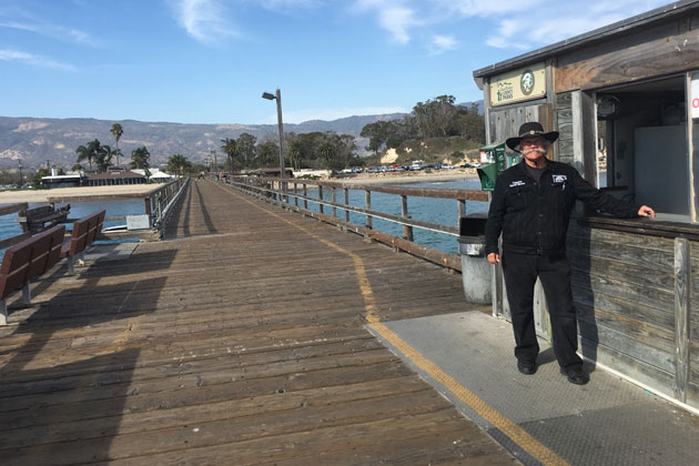 Capt. David Bacon on Goleta Pier with Goleta Beach Park in background.