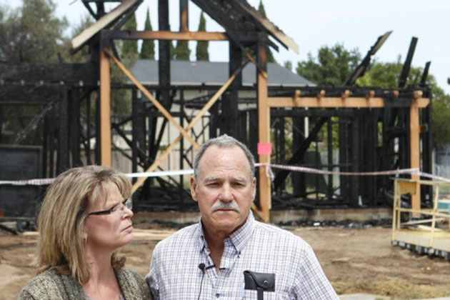 Donna and Greg France, farmers and project owners, at the scene of Nipomo housing under construction intended for farm workers. The development was struck by a suspected arsonist late Wednesday night, destroying one unit and damaging another.