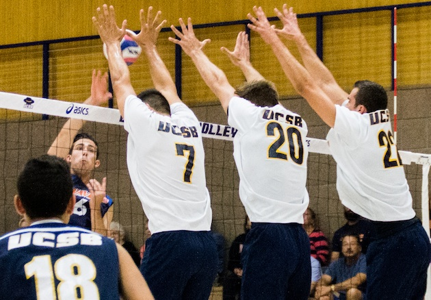 UCSB blockers Austin Kingi (7), Ryan Hardy (20) and Jonah Seif team up to deny the attack from Pepperdine's Colby Harriman.