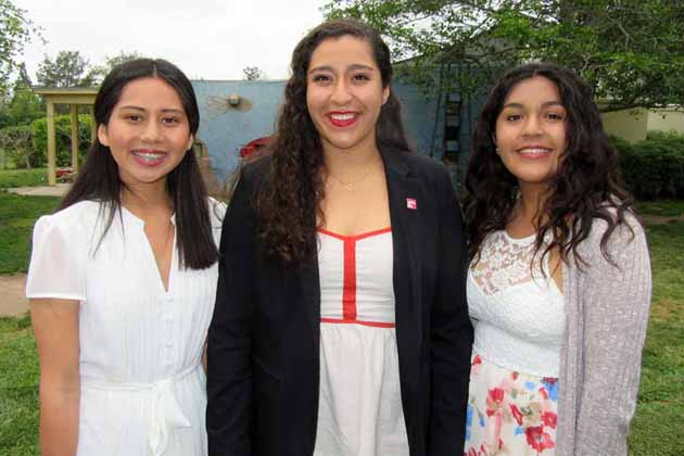Girls Inc. members Alitza Gonzalez, left, Ana Delgado and Maria Zamora emceed the luncheon.