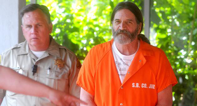 <p>Michael John Stinchfield is led from Santa Barbara court in March 2013 after the first day of his preliminary hearing on felony charges, including assault to commit rape and false imprisonment, stemming from the violent encounter with two gay women in November 2012.</p>
