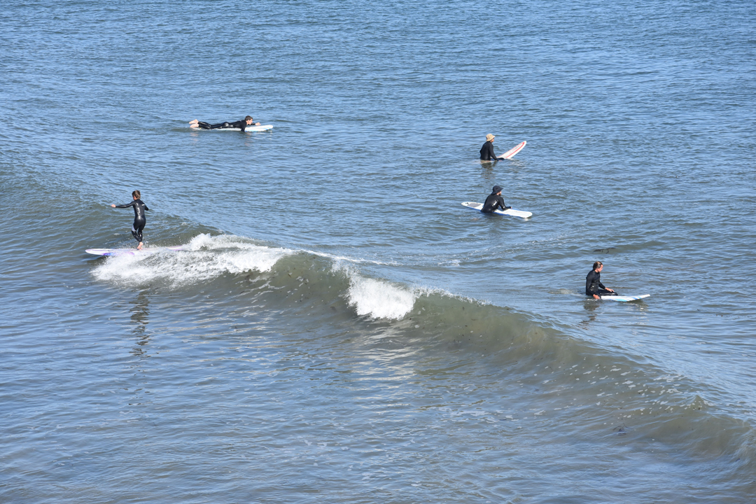 Surfers at Leadbetter Beach enjoy the warm weather Monday afternoon.