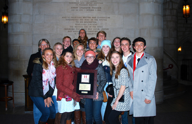 <p>The Providence Chamber Singers with their first-place award plaque in New York City.</p>