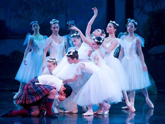 Sylphs bear their dead comrade aloft while her human lover grieves in the State Street Ballet's La Sylphide.