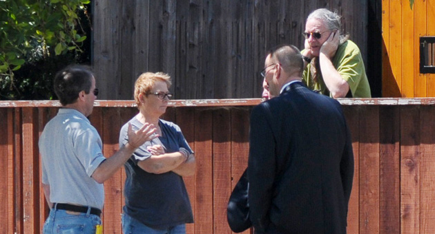 Santa Barbara police detectives interview neighbors outside a home on the 900 block of West Pedregosa Street after an intruder reportedly tried to break into a nearby residence early Wednesday but was shot by a homeowner.