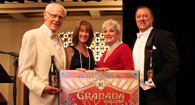 <p>Brilliant Stars honorees Michael and Anne Towbes, left, local artist Mara Abboud and former Santa Barbara Mayor Hal Conklin pose with the 90th anniversary poster commissioned by The Granada at Wednesday night&#8217;s 90th Anniversary Celebration for the Granada Theatre.</p>
