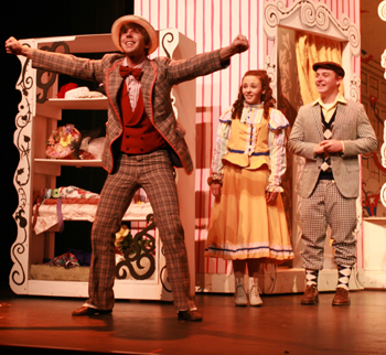 Dos Pueblos students Kevin Herald, Emma Rennick and Logan Michaels perform a scene in Hello, Dolly.