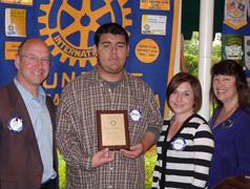 El Puente student Daniel Sotelo, second from left, is joined by Rotary Club of Santa Barbara Sunrise President Joe Weiland, left, teacher Sara Romanus and Rotary member Susan Klein-Rothschild.