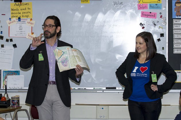 Montecito Bank & Trust employees Rob Skinner, executive VP/general counsel and chief innovation officer, and financial literacy coordinator Brianna Aguilar discuss financial concepts with students as part of the National Teach Children to Save Day program.