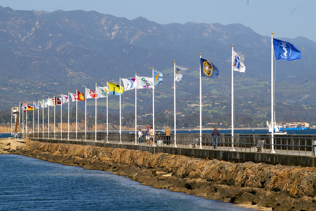Gusty winds kept the flags along the breakwater at the Santa Barbara Harbor at attention on Thursday. A High Wind Warning was issued from 8 p.m. Thursday until 11 a.m. Friday.