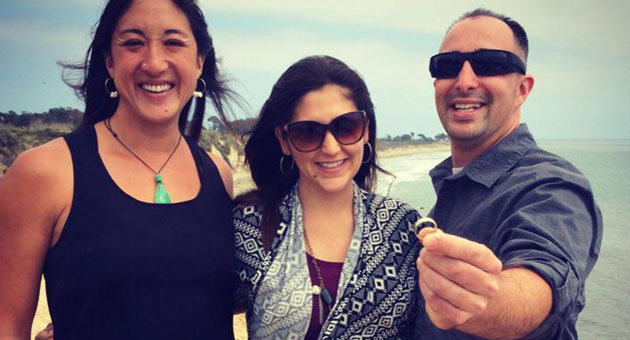 What might have been just another day at the beach for Jenn Birchim, left, led to an improbable reunion for Sara and Greg Lindsay after Birchim found their long-lost wedding ring. (Victoria Sanchez / KEYT News photo)
