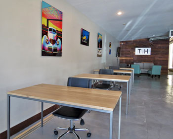 Desks at the new tech haus business incubator in santa - Garden state healthcare associates ...