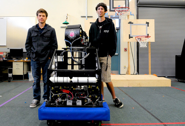 <p>Dos Pueblos Team 1717 co-drivers Lane Fuller, left, and Nicky Perez show off the Lindsay Rose robot, dedicated to a teammate who died in a 2009 surfing accident. The 120-pound machine has proven successful for the D&#8217;Penguineers, which will compete next week at the FIRST Robotic World Championships in St. Louis.</p>
