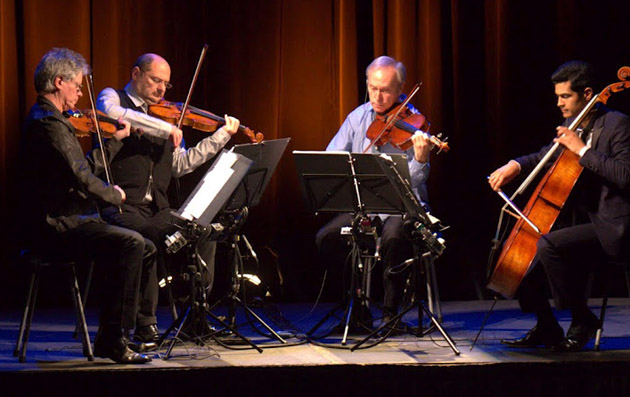 The Kronos Quartet plays the live portion of Steve Reich's Triple Quartet at Campbell Hall.