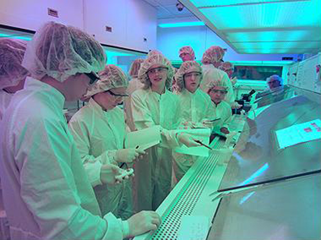 Santa Barbara Junior High School students enter a clean room during a computer chip camp at UCSB. (Santa Barbara Unified School District photo)