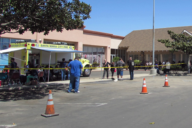 Evacuated employees wait in the parking lot near the Workforce Resource Center in Santa Maria after a hazmat incident on Friday.