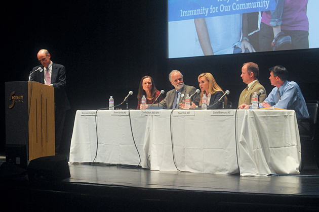 Doctors Mary-Louise Scully, from left at table, Steven Barkley, Charity Dean, David Fisk and Dan Brennan sit on a panel discussing vaccination on Thursday night at the Lobero Theatre. Sansum CEO Dr. Kurt Ransohoff moderated the event.