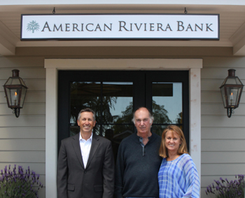 Jeff DeVine, from left, president and CEO of American Riviera Bank, board chairman Lawrence Koppelman and Laurie Leighty, senior vice president, operations and human resources, celebrates the bank's new branch in the Upper Village of Montecito. (American Riviera Bank photo)
