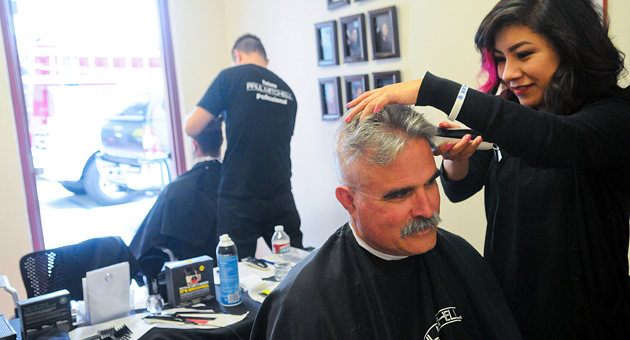 <p>Santa Barbara fire engineer Jack Franklin gets his head shaved Friday by Paul Mitchell School&#8217;s Cristina Reyes in support of fellow city firefighter Kevin Corbett, who has been undergoing treatment for testicular cancer.</p>