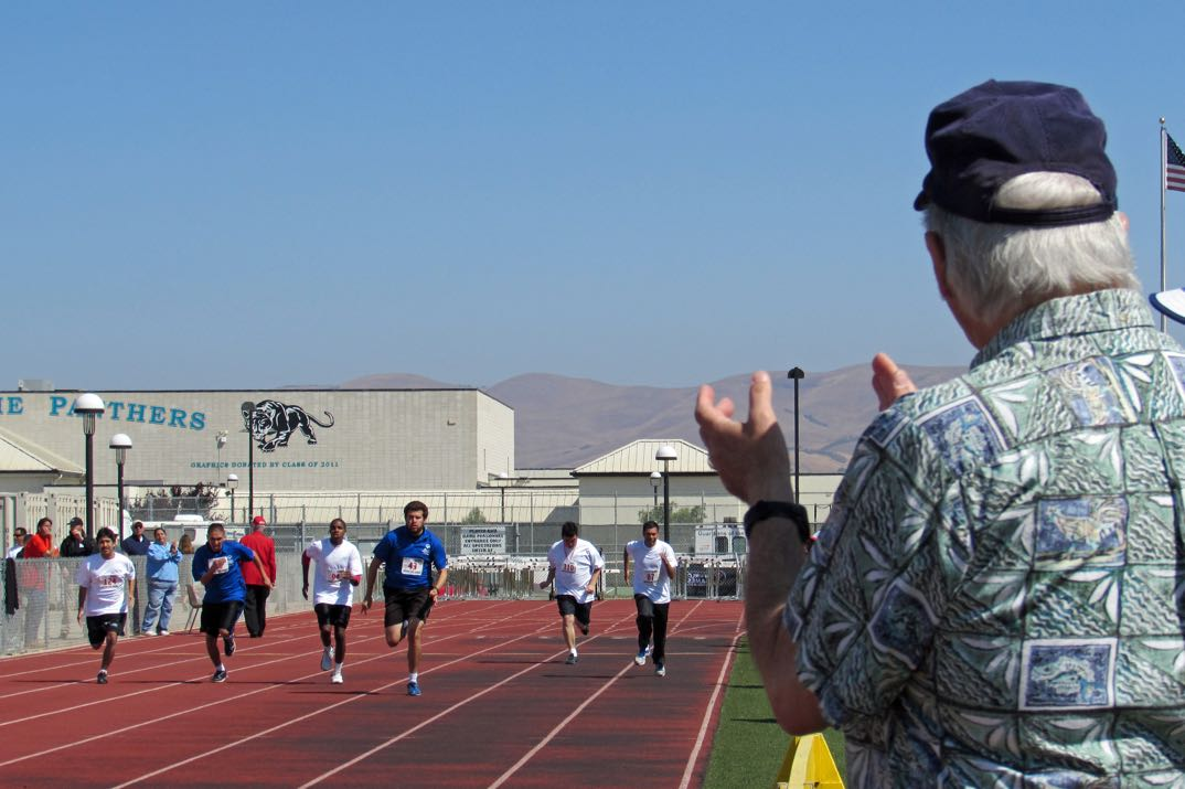 George Majoue cheers on Special Olympians at the 2015 Spring Regional Games at Pioneer Valley High School.