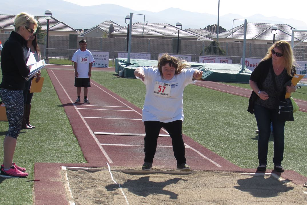 Trish Ballew competes in the standing long jump.