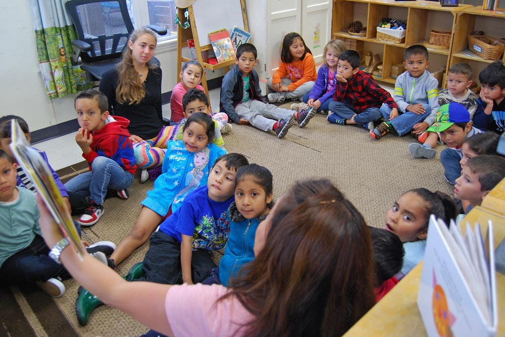 Kids listen to a story at the Isla Vista Youth Project's Children Center, which was recently purchased by the nonprofit.