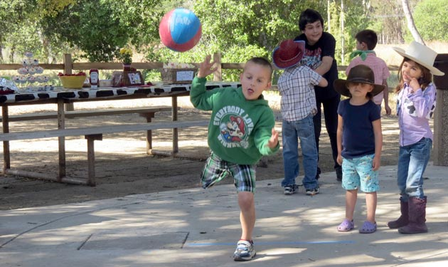 Kindergartners in the Orcutt Academy Independent Study program participate in milk bottle bowling on a recent morning at Pioneer Park in Santa Maria. (Gina Potthoff / Noozhawk photo)