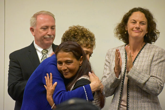 District Attorney Joyce Dudley, in blue, hugs Citizen of Courage Award recipient Maria Navarro, mother or Santa Maria homicide victim Anthony Ibarra, on Wednesday. Behind them are Santa Maria police Chief Ralph Martin and Senior Deputy District Attorney Ann Bramsen.