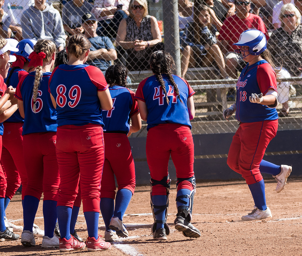 San Marcos players wait for Hailee Rios to come home after hitting a three-run homer in the third inning.