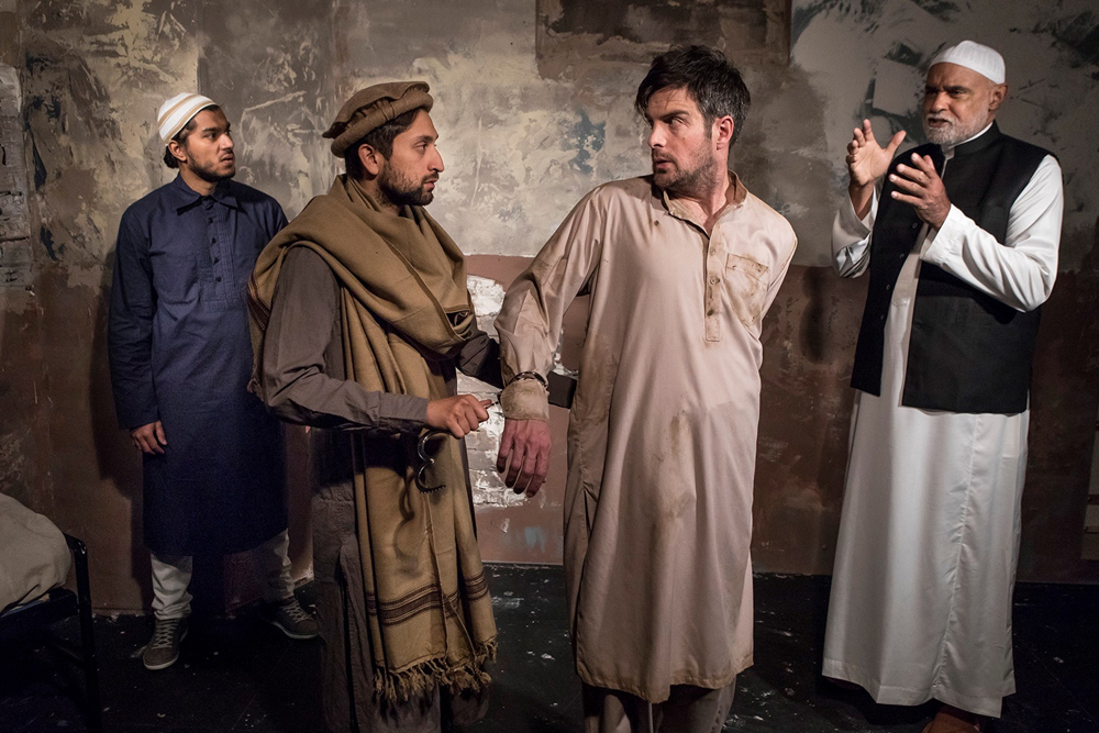 "Jameal Ali, left, Sarang Sharma, John Tufts and Mujahid Abdul-Rashid star in Ensemble Theatre Co.'s ""The Invisible Hand"" by Ayad Akhtar."